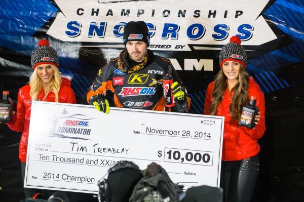 Tim Tremblay with the $10,000 winner's check after beating all challengers in the head-to- head Dominator race.
