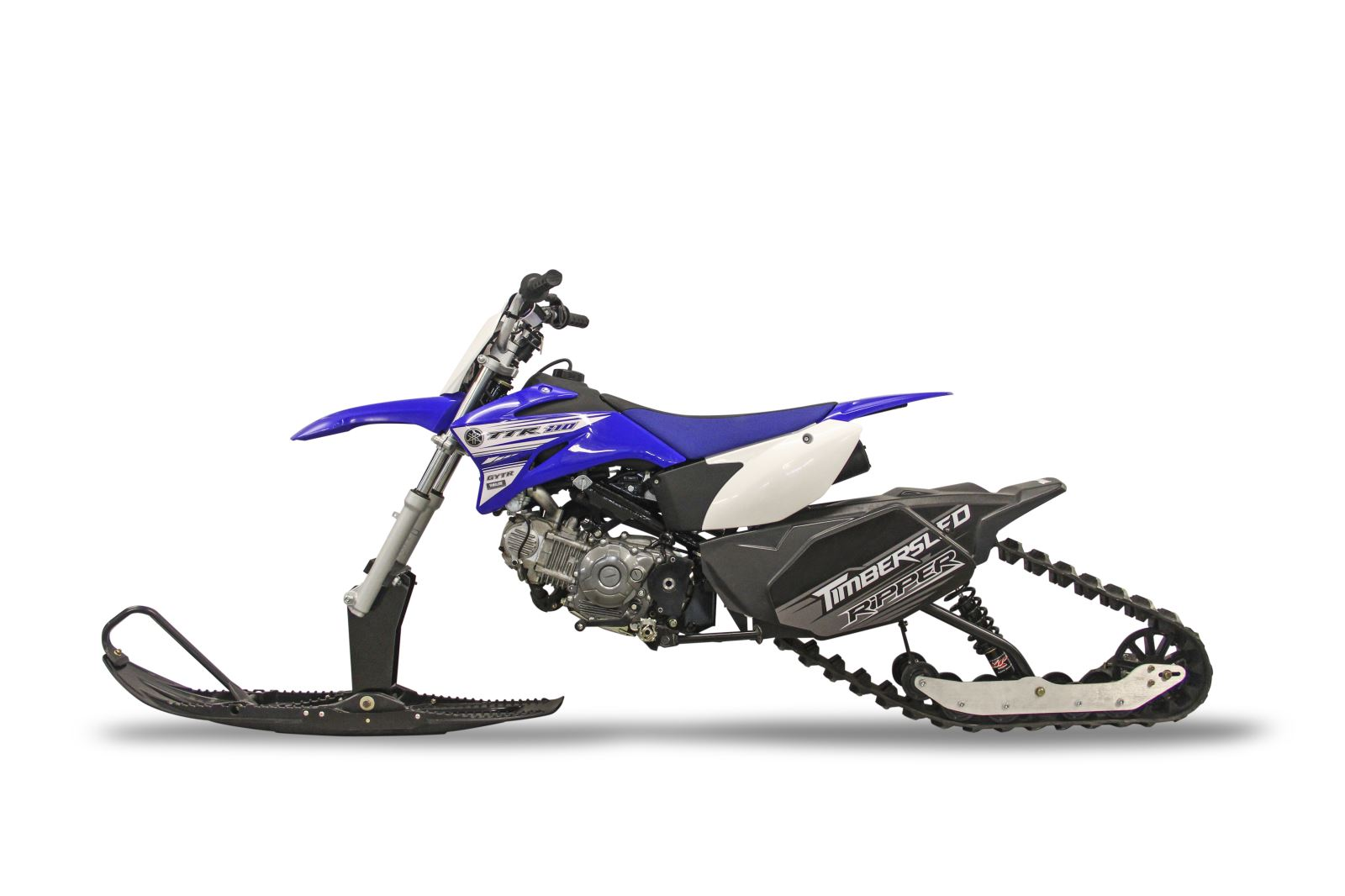 new timbersled st 90 ripper systems convert 110cc dirt bikes into snow bikes for year
